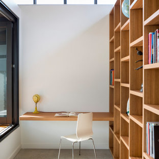 Mid-sized contemporary home office in Sydney with white walls, concrete floors, grey floor, no fireplace and a built-in desk.