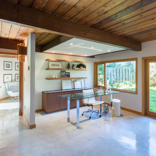 Example of a huge 1950s freestanding desk concrete floor and gray floor home office design in Vancouver with white walls