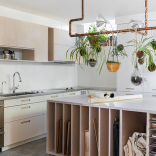 Example of a danish concrete floor and gray floor home studio design in Seattle with white walls