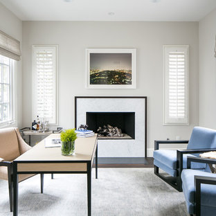 Inspiration for a mid-sized beach style freestanding desk study room remodel in Orange County with gray walls, a stone fireplace and a ribbon fireplace