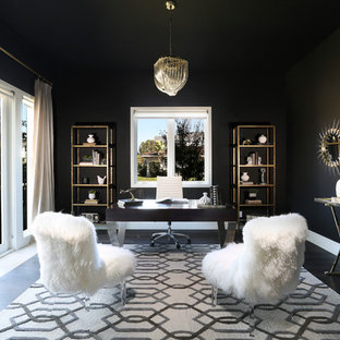 Inspiration for a mid-sized modern freestanding desk home office remodel in Orange County with black walls