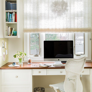 Inspiration for a transitional built-in desk light wood floor study room remodel in Boston with white walls