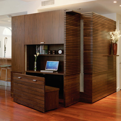 Inspiration for a contemporary built-in desk medium tone wood floor study room remodel in New York