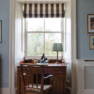 Photo of a small classic study in London with carpet, a freestanding desk and beige floors.