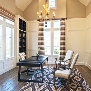 Inspiration for a mid-sized transitional freestanding desk dark wood floor study room remodel in Houston with beige walls and no fireplace