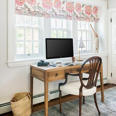 Mid-sized cottage freestanding desk medium tone wood floor study room photo in Boston with white walls
