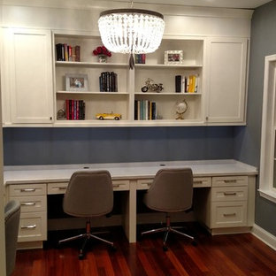 Inspiration for a medium sized contemporary study in Philadelphia with purple walls, medium hardwood flooring, a built-in desk and brown floors.