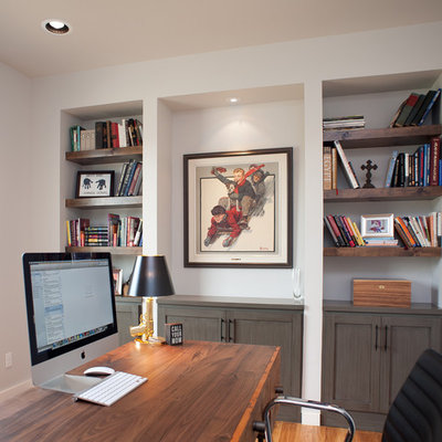 Mid-sized trendy freestanding desk light wood floor study room photo in Oklahoma City with white walls and no fireplace