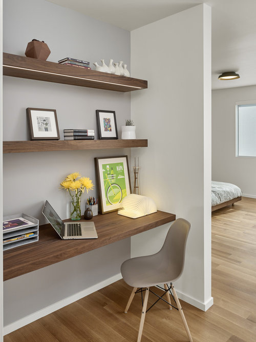 inspiration for a small 1950s built in desk light wood floor study room remodel in