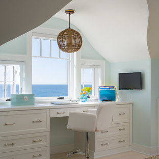 Home office - beach style built-in desk home office idea in Providence