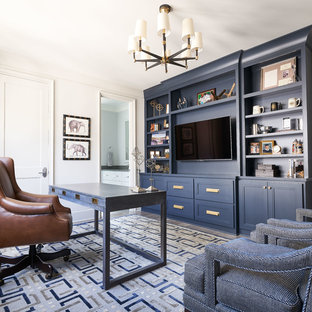 Example of a transitional freestanding desk medium tone wood floor and gray floor home office design in Charlotte with white walls