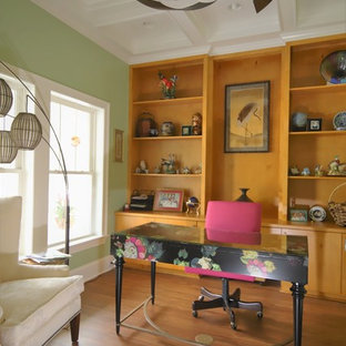 Inspiration for a mid-sized freestanding desk vinyl floor and brown floor home office library remodel in Raleigh with green walls and no fireplace