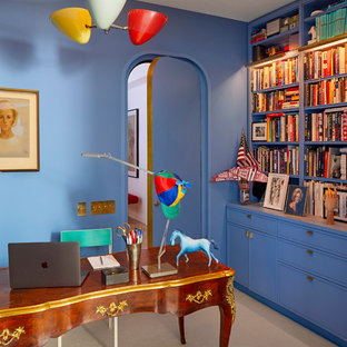 Inspiration for a mid-sized contemporary freestanding desk carpeted and beige floor home office library remodel in New York with blue walls