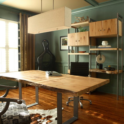 Example of a mid-sized eclectic freestanding desk medium tone wood floor and brown floor home studio design in Atlanta with green walls and no fireplace