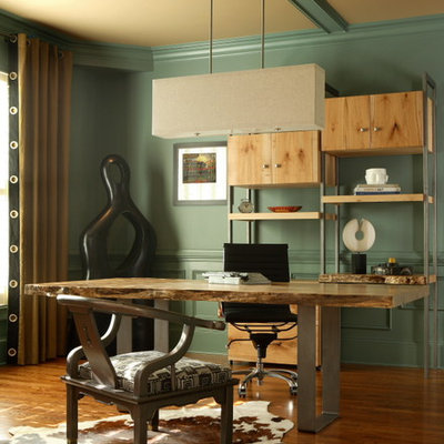 Inspiration for a mid-sized eclectic freestanding desk medium tone wood floor and brown floor study room remodel in Atlanta with green walls and no fireplace