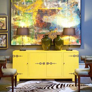 Ispirazione per un piccolo studio boho chic con moquette e pareti blu