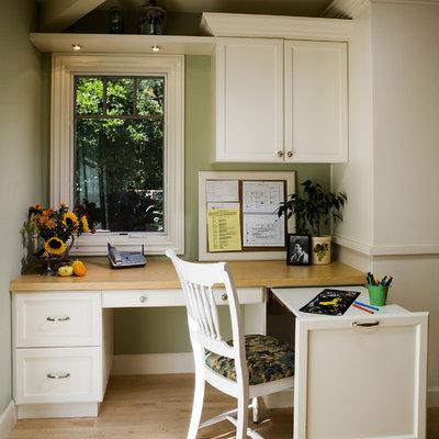Elegant built-in desk home office photo in San Francisco