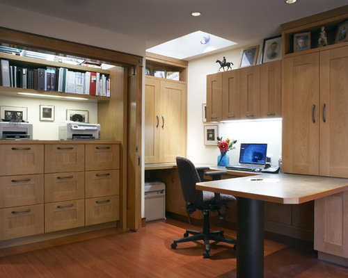 inspiration for a contemporary built in desk medium tone wood floor home office remodel in