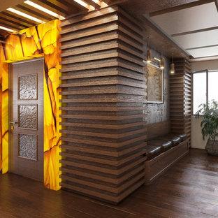 他の地域の広いモダンスタイルのおしゃれなアトリエ・スタジオ (白い壁、無垢フローリング、標準型暖炉、金属の暖炉まわり、造り付け机、茶色い床) の写真