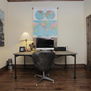 Urban freestanding desk dark wood floor home office photo in Dallas with white walls