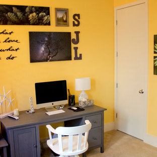 Design ideas for a small contemporary study in San Francisco with yellow walls, carpet, no fireplace and a freestanding desk.