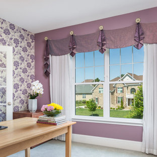 Design ideas for a medium sized eclectic home office in Raleigh with purple walls, a freestanding desk and white floors.