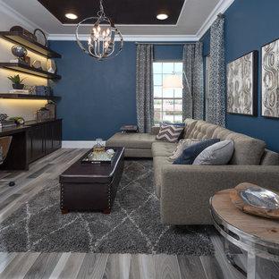 Esempio di un grande ufficio minimal con pareti blu, pavimento con piastrelle in ceramica, nessun camino e scrivania incassata