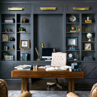 Large transitional freestanding desk dark wood floor and brown floor study room photo in Atlanta with gray walls