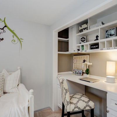 Example of a small classic built-in desk carpeted study room design in Los Angeles with gray walls