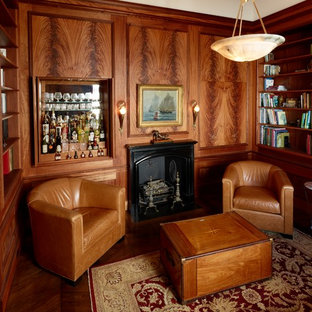 Medium sized classic home office in Boston with medium hardwood flooring, brown floors, a reading nook, brown walls, a standard fireplace and a metal fireplace surround.