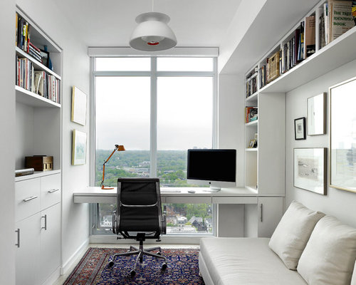Small scandinavian built-in desk study room idea in Toronto with white walls