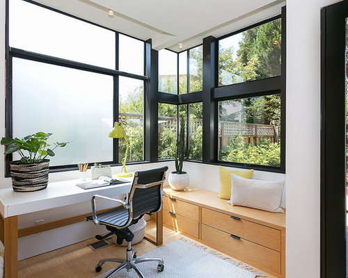 inspiration for a midcentury modern freestanding desk beige floor study room remodel in san francisco with - Mid Century Modern Home Office