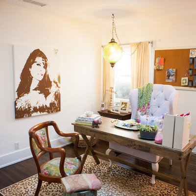 Home office - eclectic freestanding desk dark wood floor home office idea in Los Angeles with white walls