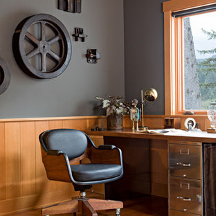 Home office - industrial home office idea in Portland with gray walls