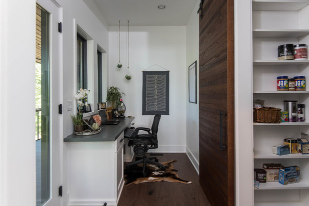 Rustic Home Office by Living Stone Design + Build