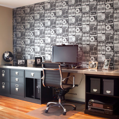 Example of a trendy built-in desk medium tone wood floor study room design in San Francisco with multicolored walls