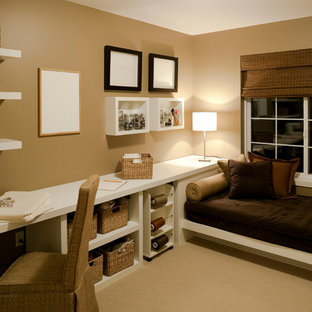 Example of a transitional built-in desk carpeted craft room design in Nashville with brown walls and no fireplace
