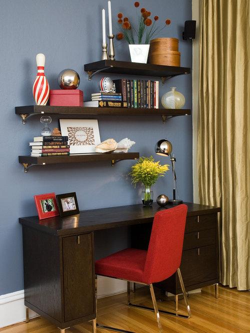 Small contemporary freestanding desk medium tone wood floor and blue floor  home office idea in San