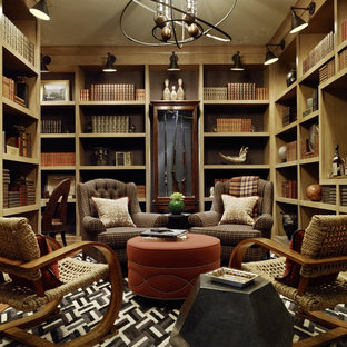 Example of a classic medium tone wood floor home office library design in San Francisco with brown walls and no fireplace