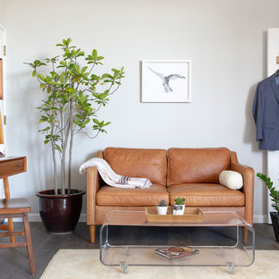 Inspiration for a mid-sized 1960s freestanding desk dark wood floor and brown floor study room remodel in San Francisco with gray walls and no fireplace