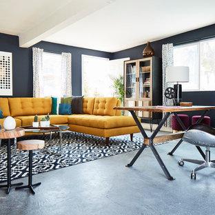 Esempio di un grande studio contemporaneo con pareti grigie, pavimento in cemento, nessun camino, scrivania autoportante e pavimento grigio