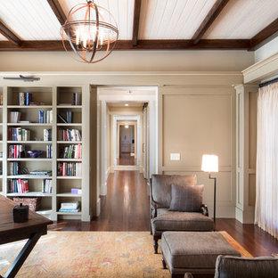 Ispirazione per un ufficio classico di medie dimensioni con pareti beige, parquet scuro, camino classico, cornice del camino in mattoni e scrivania autoportante