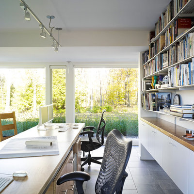 Inspiration for a large contemporary built-in desk ceramic tile home office remodel in Bridgeport with white walls and no fireplace