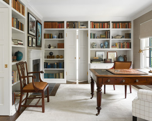 example of a classic freestanding desk home office library design in seattle with a standard fireplace