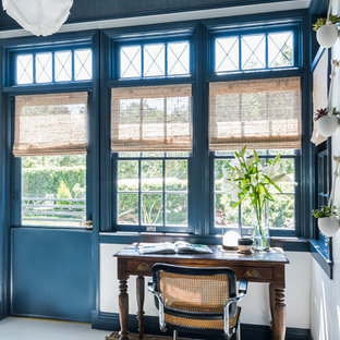 Inspiration for an eclectic freestanding desk white floor study room remodel in Los Angeles with blue walls