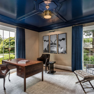 Inspiration for a large transitional freestanding desk dark wood floor and brown floor study room remodel in Other with beige walls and no fireplace