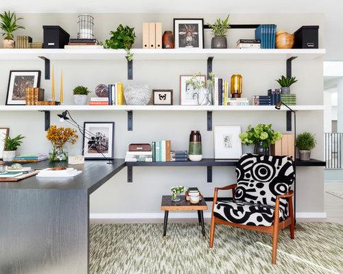 Example Of A Trendy Built In Desk Beige Floor Study Room Design In London  With