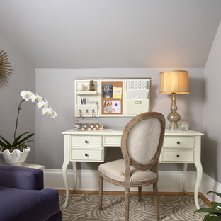 Elegant freestanding desk medium tone wood floor home office photo in Minneapolis with gray walls
