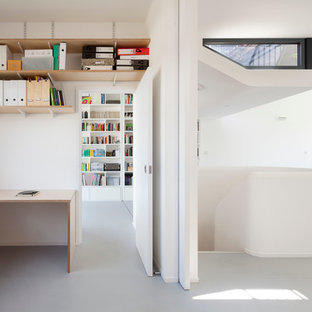 Study room - mid-sized scandinavian built-in desk vinyl floor study room idea in London with white walls and no fireplace