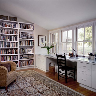 Example of a trendy built-in desk home office design in San Francisco